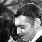fotografia de una escena de cine del actor estadounidense clark gable y una mujer