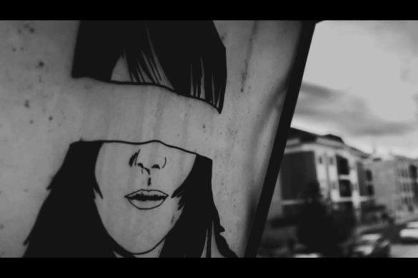 graffiti en pared de una mujer con los ojos vendados victima de la violencia de genero